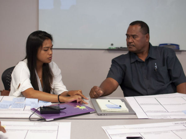 Fellows Jihan Younis (CNMI) and Mas Tkel (Palau) discuss their Big Idea Palette boards.