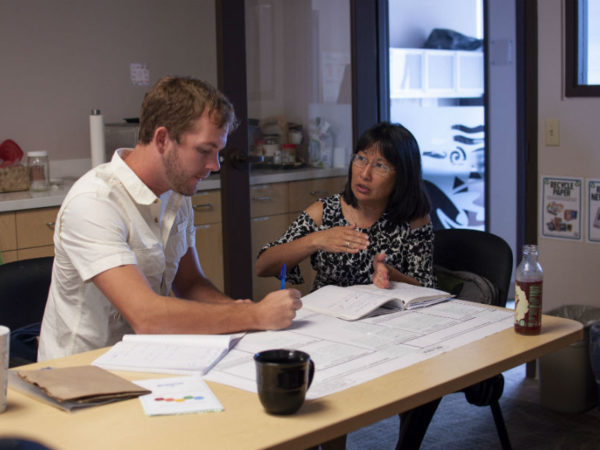 Pacific Resiliency Fellow Pat Keeler (Guam) and his mentor, Jodi Chew, U.S. Forest Service discuss his project to work with landowners to remove invasive bamboo from riparian corridors.