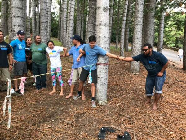 Fellows work together in a low ropes course to build leadership skills and foster collaboration.